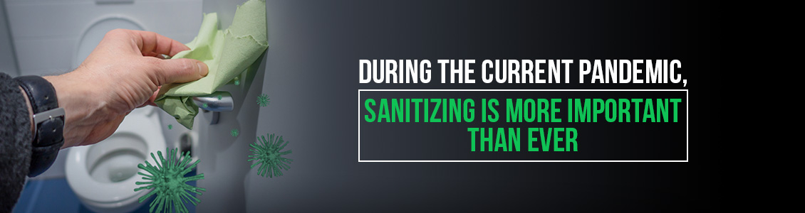 An Image Depicting Man Wiping and Sanitizing Stall Handle Which is Important During a Pandemic